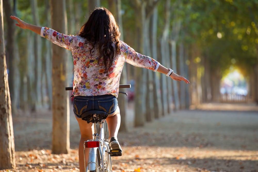 young girl riding bike outside