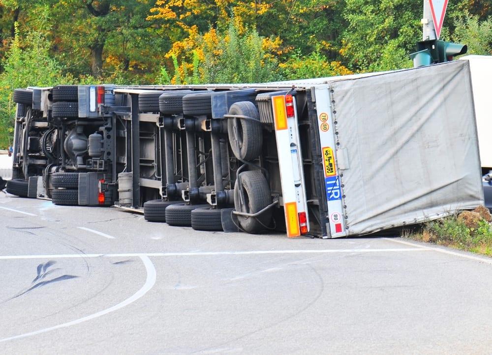 overturned semitruck on road